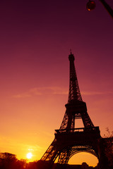 Eiffel Tower silhouette at evening sunset light in Paris France