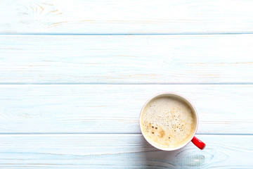 Cup of coffee on a blue wooden table