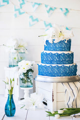 Amazing Wedding cake with decoration on white wooden table