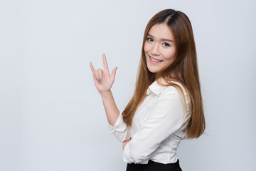 Young beautiful smiling Asian woman student with I love you hand sign.