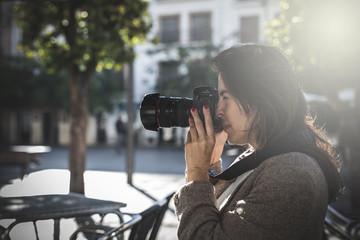 Beautiful Female photographer shooting