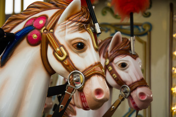 Old French carousel in a holiday park. Merry-go-round with horses.