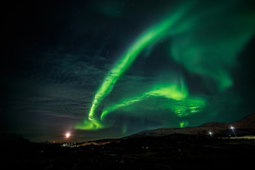 Northern lights and the rising Moon nearby nuuk city, Greenland