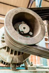 Vertical photo in color and shallow depth of field about an engine with rubber bands to work