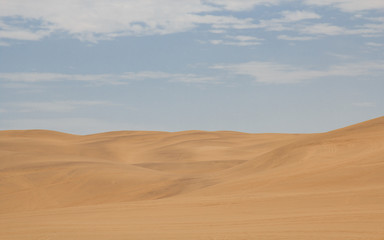 view from the road to the African dunes in the desert near the o