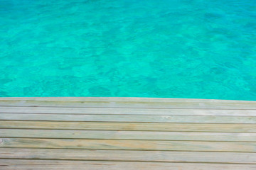 Wooden planks in tropical Maldives island and beauty of the sea