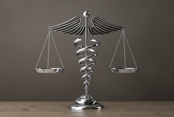 Silver Medical Caduceus Symbol as Scales. 3d Rendering