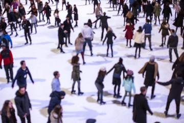 Blurred people ice skating