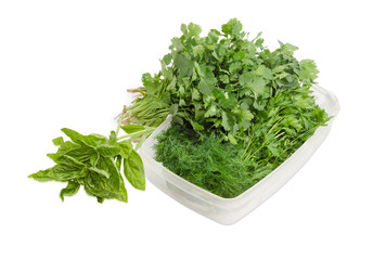 Bunches of parsley, dill, green basil and coriander