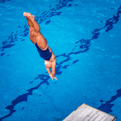 Female diver. Female diver jumping into the pool