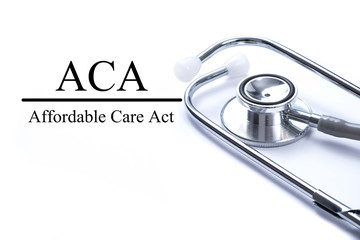 Page with ACA (Affordable Care Act) on the table with stethoscop