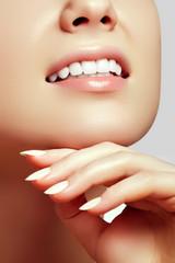 Healthy woman teeth and a dentist mouth mirror. Dental hygiene