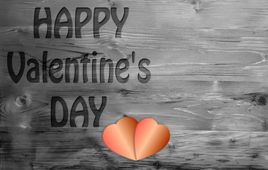 Happy Valentines day and heart on a wooden background.
