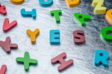 YES word with colourful alphabet blocks made of wooden. Business