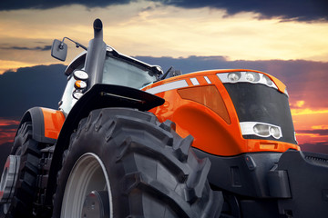 Fototapete - Tractor on a background cloudy sky