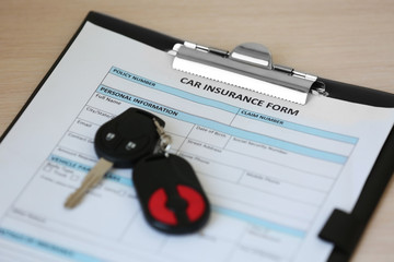 Key on document. Concept of car insurance