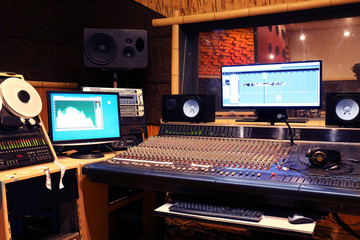 Sound engineer workplace in recording studio Wall mural