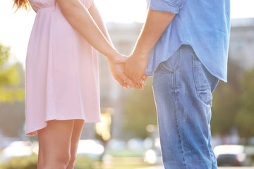 Young couple holding hands together