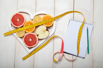 diet plan and centimeter on a white background