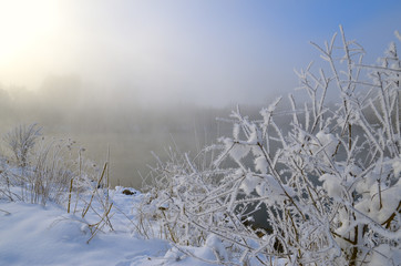 Frosty Morning on the lake, fog and frost on the grass.