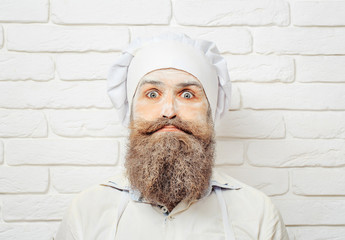 Man with flour on face