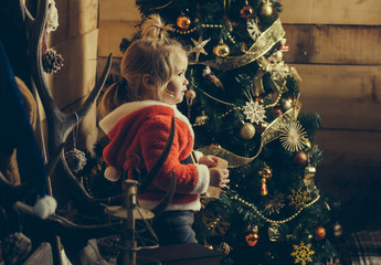 christmas boy at tree with paper