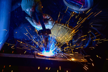 Industrial steel welder in factory technical,