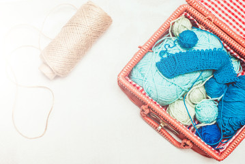 beautiful still life with clews wool yarn in a basket