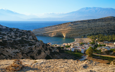 Top view of the village of Matala and caves where the hippies lived. Tourist destination on the island of Crete. Greece.