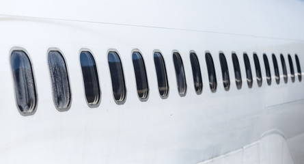 Passenger aircraft windows. View with perspective from outside.