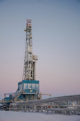 In the northern oil and gas field. Drilling rig. Before her lay the drill pipes.