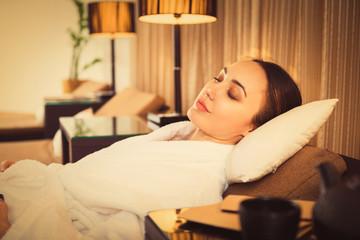 Serene girl sleeping in wellness center
