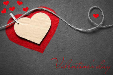 Black white red. Valentine's day. Heart from cardboard on rope with clothespin on black and white background with the gradient effect.