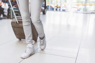 Young girl walking with luggage