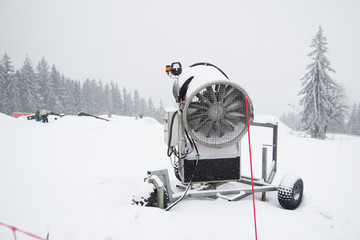 A snow cannon being used to cover a mountain - Snowmaking