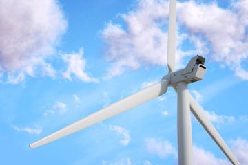 Wind turbine on sky background.