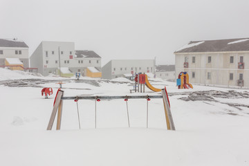 Harsh greenlandic childhood,playground covered in snow and ice i