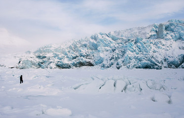 The glacier and the man. This is the glacier Nordenskiöldbreen near Pyramiden, on the coast of Billefjord, Svalbard.