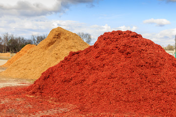 Poster Cuban Red Red Mulch or Wood Chip Mound Mound of black mulch or wood chips use for landscaping top ground material and accents.