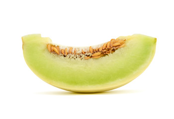 sliced honeydew melon isolated on white background