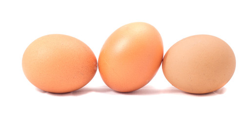 three chicken eggs