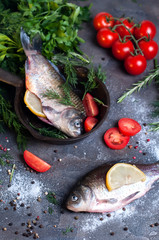 Delicious fresh fish on dark vintage background.