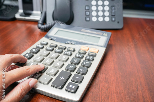 Woman Use Calculator In Office For Tax And Income