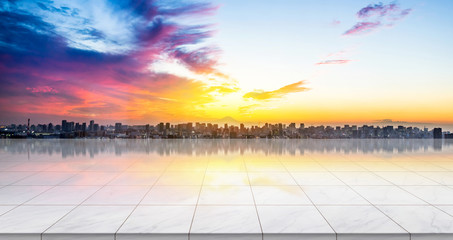Business concept - Empty marble floor top with panoramic modern cityscape building bird eye aerial view under sunrise and morning blue bright sky of Tokyo, Japan for display or montage product