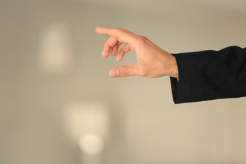 Male hand with finger pointing on blurred background