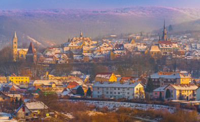 Wall Mural - Panoramic view over the medieval fortress Sighisoara city in winter season, Transylvania, Romania