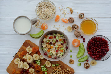 Healthy eating. Oatmeal with fruit and candied fruit