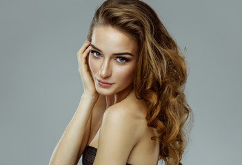 Beauty portrait of female young model with natural skin