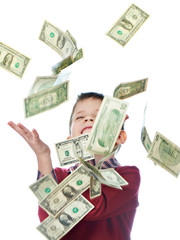Little boy and flying dollar bills isolated