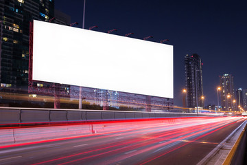 Double exposure of blank billboard on blur light trails, street and urban in the night - can advertisement for display or montage product or business.